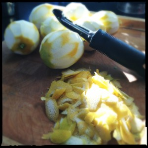 Lemons with zest peeled off.