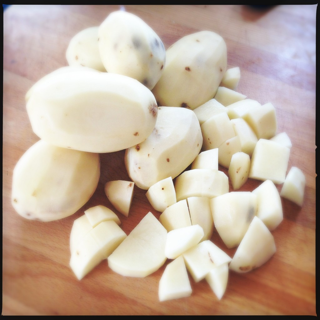 Peeled and cubed, ready to be boiled in cold water.