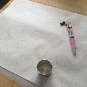 Tracing out circle guidelines on the parchment paper.  And yes, that is my Hello Kitty! mechanical pencil