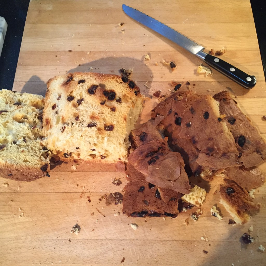 Cutting the crust of the panettone